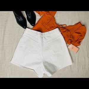 Vintage High waisted white denim shorts.